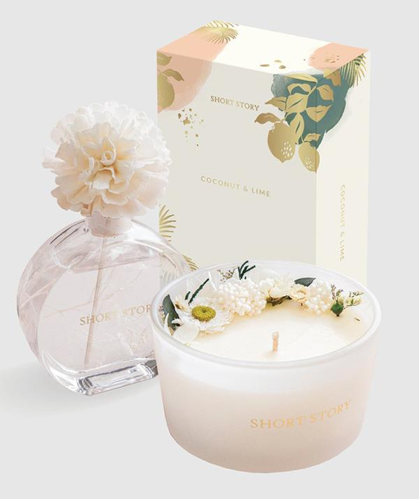 """Candles are often seen as the go-to gift for when you don't know what to give. This heavenly duo from Short Story, are however, well, another story. Not only do the candle and diffuser look beautiful having been adorned with real flowers, they smell incredible too. <br><br>  ***Short Story Candle and diffuser pack in coconut lime, $75, [shop it here.](https://www.theiconic.com.au/candle-and-diffuser-pack-coconut-lime-1127475.html