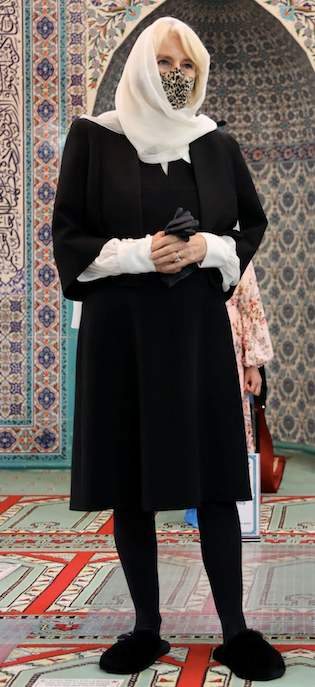 Camilla swapped into a pair of slippers as she stepped inside the Mosque.