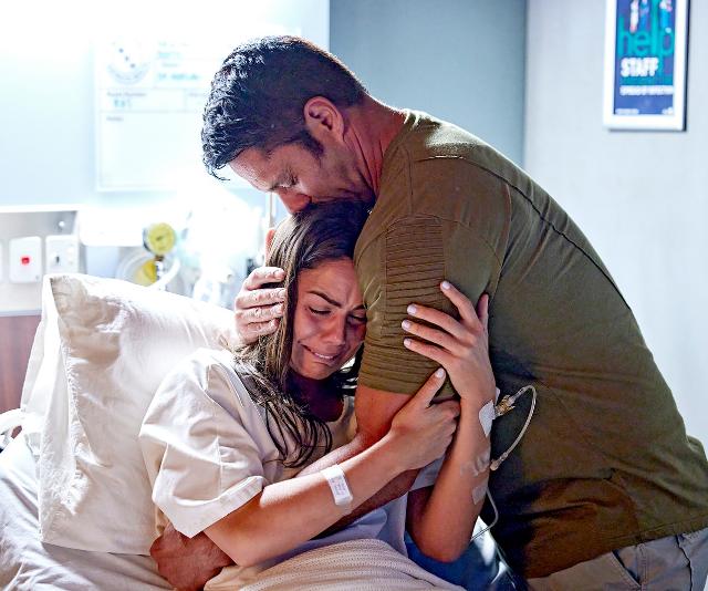 Mac sobs in Ari's arms.
