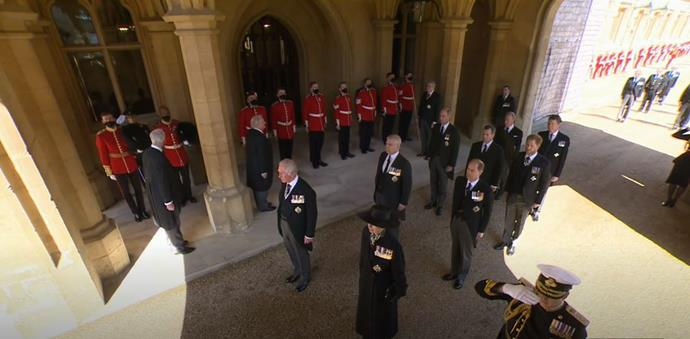 Members of the British royal family are seen - Prince Charles, Princess Anne stand before Prince Andrew and Prince Edward. Behind them are Prince Harry and Prince William.