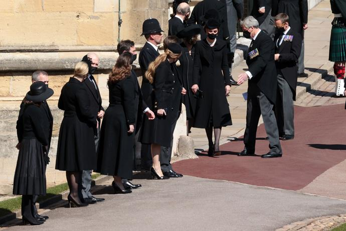 Princess Eugenie, Princess Beatrice, Duchess Catherine and more stand beside the chapel ahead of the service.