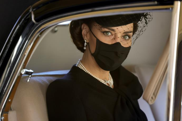 The Duchess added a black hat and veil.