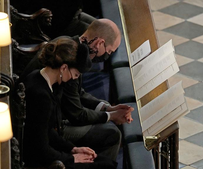 Prince William and Duchess Catherine share a quiet moment of prayer.
