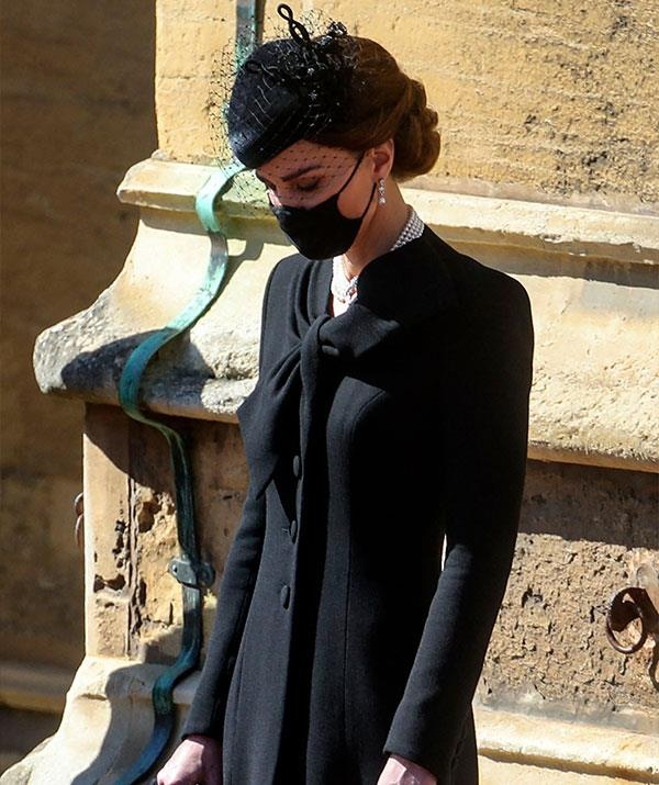 An emotional Duchess Catherine bows her head in respect to her grandfather in-law.