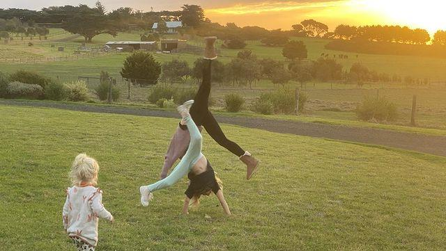 The kids do cartwheels against a gorgeous sunset.