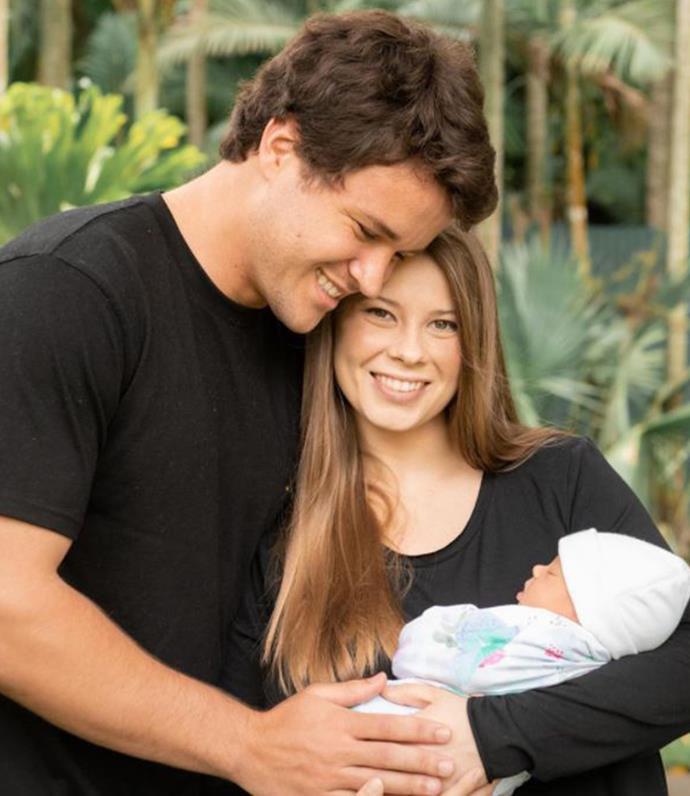 Bindi with her husband Chandler cradling their newborn daughter, Grace.