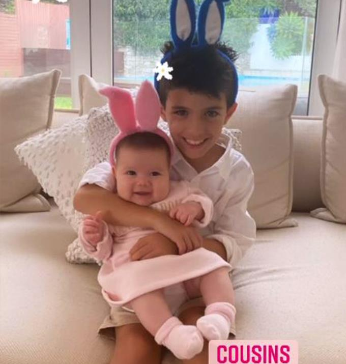 Ada's son Johnas cuddling his cousin, Sofia.