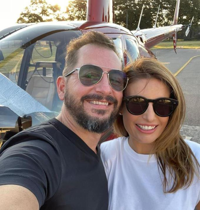Birthday date! Ada with her partner Adam before boarding their helicopter journey.