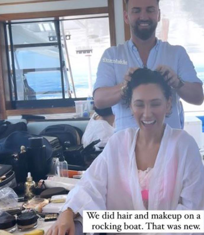 Zoë getting he beauty look done on a boat.