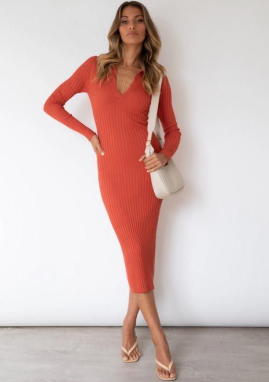 "Gingham & Heels Jayda Knitdress in rust, $69. **[Buy it online here](https://ginghamandheels.com/products/jayda-knit-midi-dress-rust target=""_blank"" rel=""nofollow"")**"