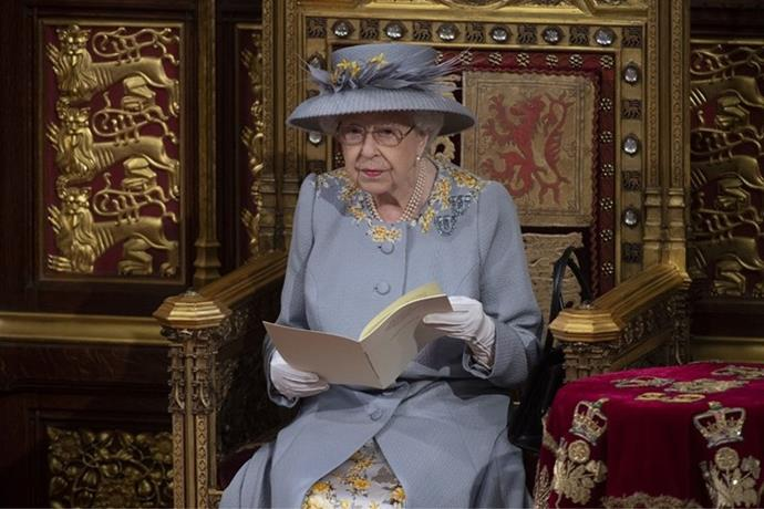 The Queen sat alone as she delivered the speech.