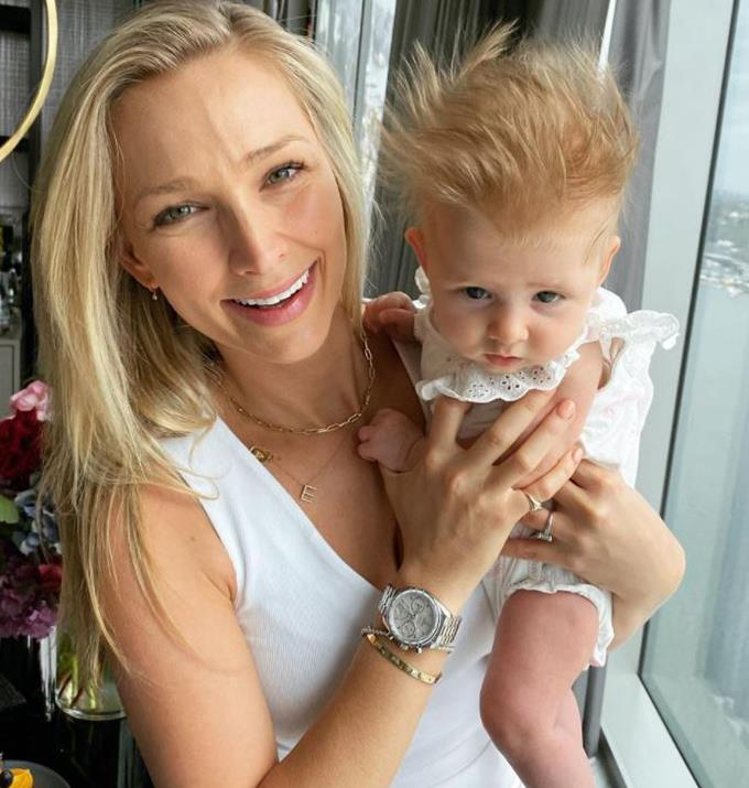 Anna with her daughter during a hotel stay.