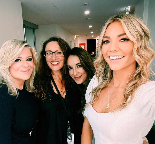 Ready to rumble! The gorgeous women of Summer Bay pose with their savvy makeup artist Laura Vazquez as they prepare to shoot.