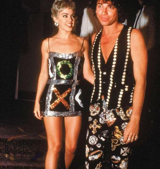 """Speaking to *Vogue* Kylie included this iconic look with Michael Hutchence as one of her favourite fashion moments of all time.  <br><br> """"December 1989, The Delinquents premiere in Sydney, Australia. I attended with Michael Hutchence and it was a moment. The short blonde hair was a last-minute decision. I don't recall us planning to match so well, but we did. My noughts and crosses mini-dress was by the Aussie designers, Morrissey Edmiston,"""" shared Kylie."""