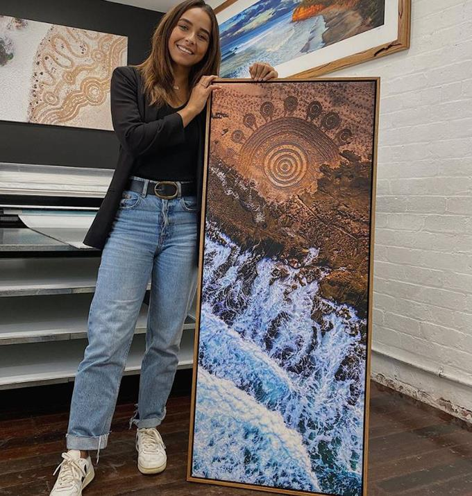 She is just a head taller than this gorgeous painting.