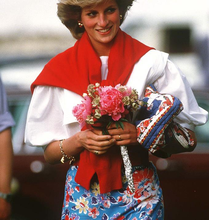 Diana was matching her bag to her skirt and her sweater to her flowers at the polo.
