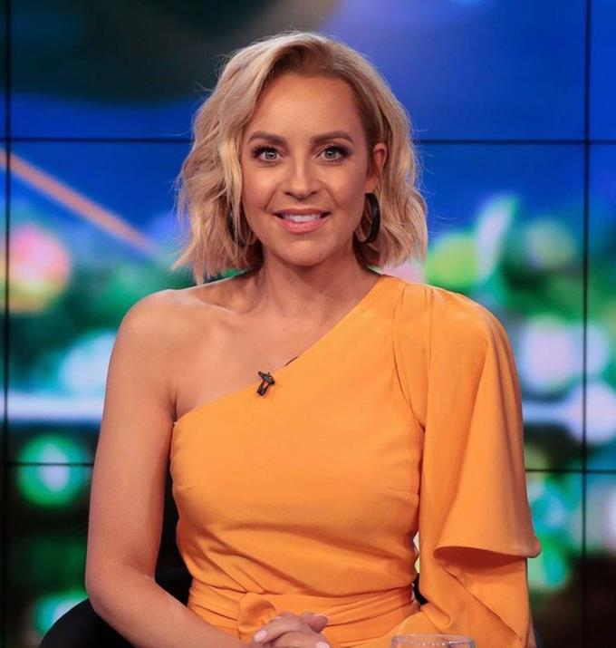 This dress has all the sass up its sleeve! We are obsessed with how this tangerine dress pops on Carrie, who is absolutely dazzling our screens enough as it is every night.