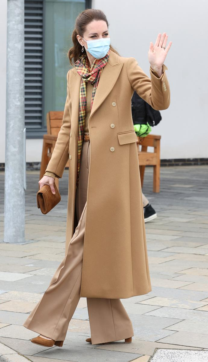 The Duchess looked chic in a long brown overcoat.