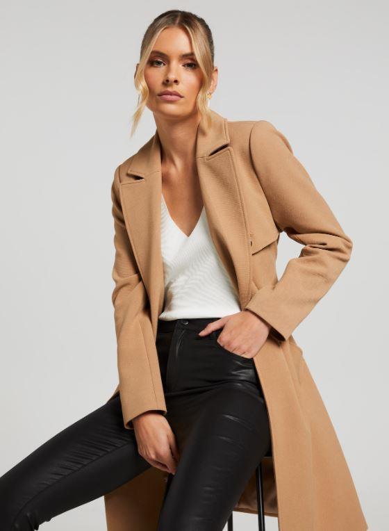 """Portmans Lola Trench Coat, $127.96 (on sale). **[Buy it online here](https://www.portmans.com.au/shop/en/portmans/lola-trench-coat?colour=Camel target=""""_blank"""" rel=""""nofollow"""")**"""