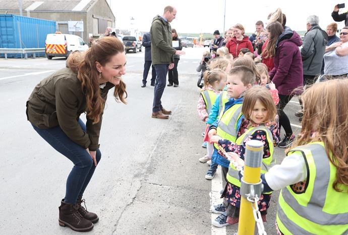On day two of Kate and William's Scotland visit, the Duchess dressed down for the afternoon - again in her favourite skinny jeans and boots. She also wore a green hooded jacket, with her hair in its iconic half-up-half-down style.
