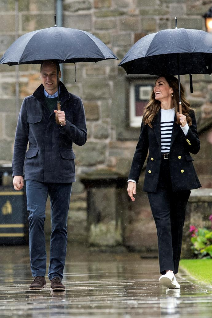 Earlier in the day, the Duke and Duchess enjoyed some special time together visiting the very place they met,  the University of St Andrews. There, the Duchess went nautical in a jumper and shoulder-padded jacket with golden buttons. She also wore a pair of Veja sneakers for the occasion.