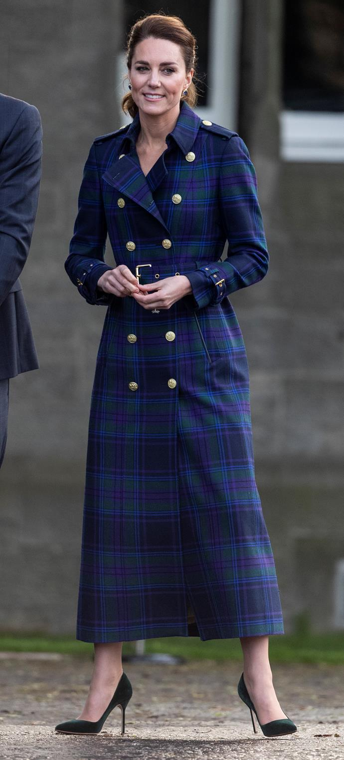 """Queen of the tartans Kate Middleton looked stunning in this perfect navy and green Marlborough Trench Coat by Holland Cooper (worth a cool AUD$1,500, might we add) for a special screening of *Cruella* at Holyroodhouse in Edinburgh. The event took place [in the evening of the third day](https://www.nowtolove.com.au/royals/british-royal-family/prince-william-kate-middleton-secret-date-67855 target=""""_blank"""") of their joint tour."""