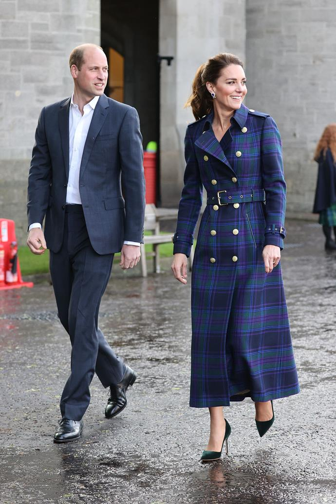 The Duchess's dreamy trench featured large gold buttons and a belted waist. She also added a pair of stunning sapphire earrings which are on loan from The Queen.
