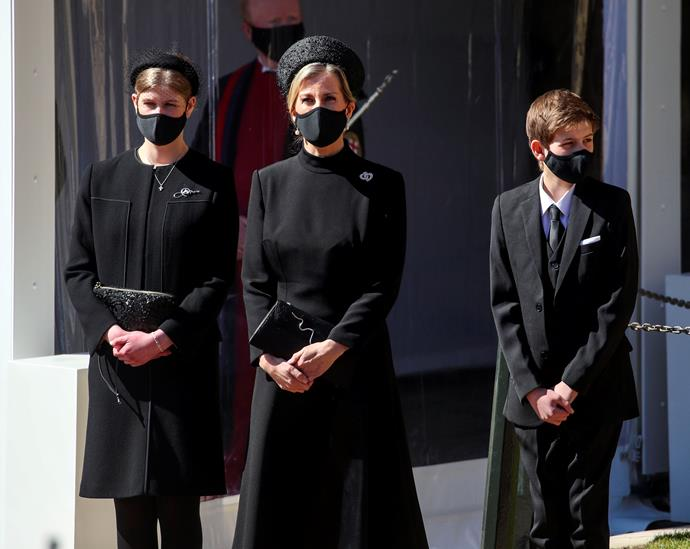 Lady Louise stands beside her mother Sophie and brother James at the funeral of Prince Philip in 2021.