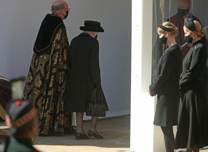 Watching with respect as her grandmother The Queen enters the funeral.