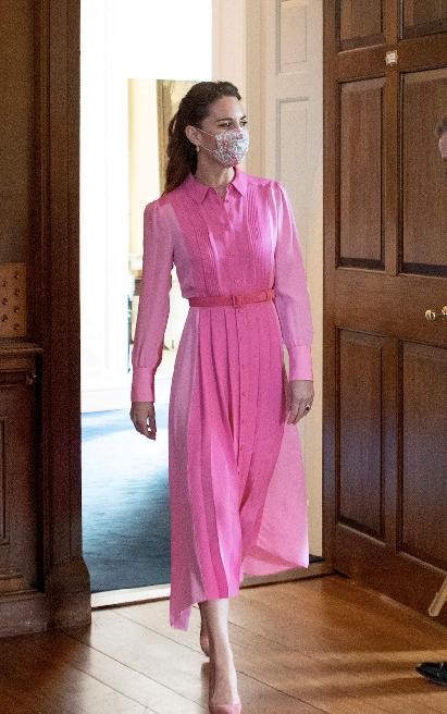 """Just before the Beating Retreat, Kate had a sweet Princess moment with a young cancer patient, wearing this gorgeous ME+EM gown. Young Mila was also dressed for the occasion, wearing a matching pink frock. More on the beautiful moment [here.](https://www.nowtolove.com.au/royals/british-royal-family/kate-middleton-pink-dress-67869 target=""""_blank"""")"""