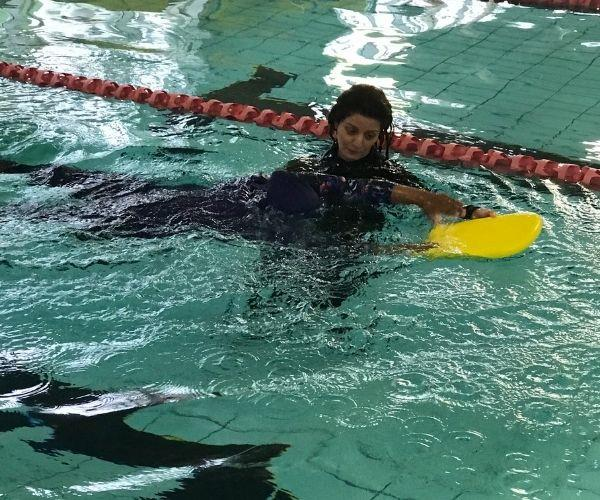 Now I'm teaching others how to swim!