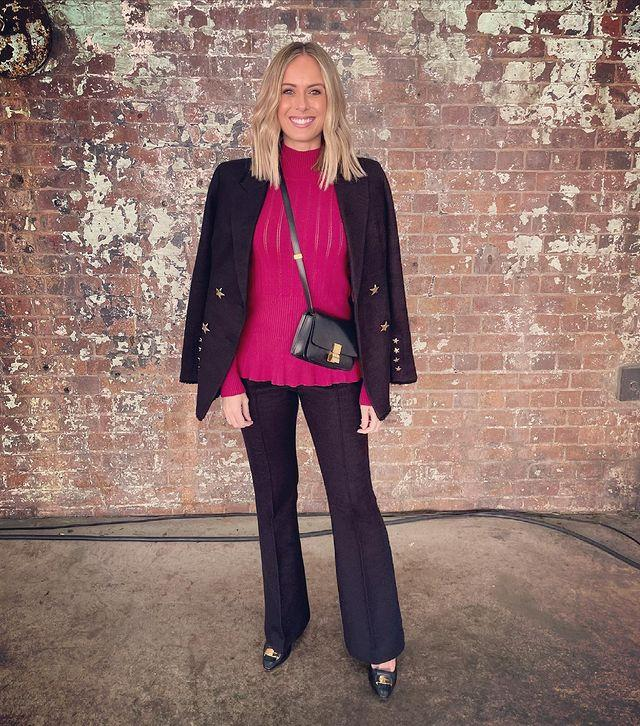 New mum Sylvia Jeffreys glammed up for day one wearing Rebecca Vallance for the designer's show. The pop of red paired with a classic flare has us dreaming for the winter ahead.