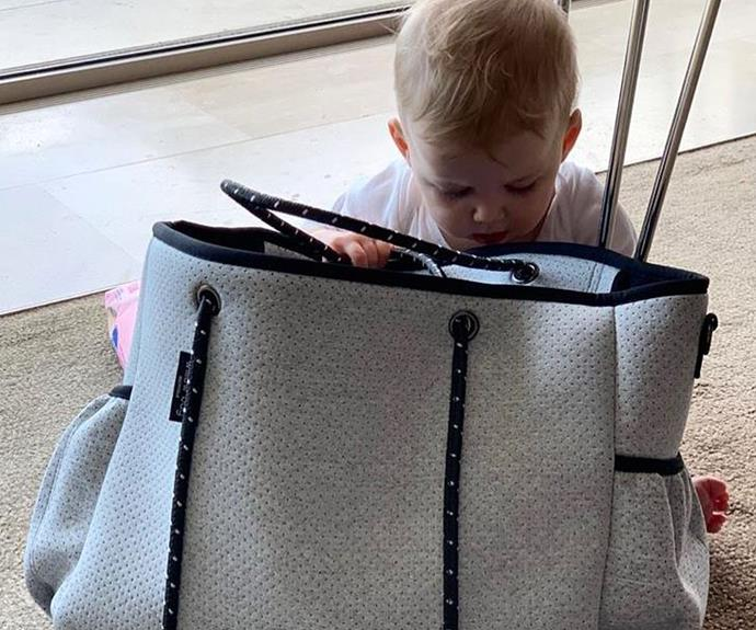 """""""So it's begun.. Harper's got her eyes (and little fingers) on my handbags,"""" Jasmine captioned this sneaky moment."""