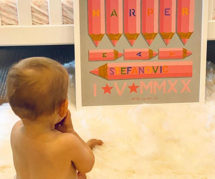 Harper adoring the sweet artwork.