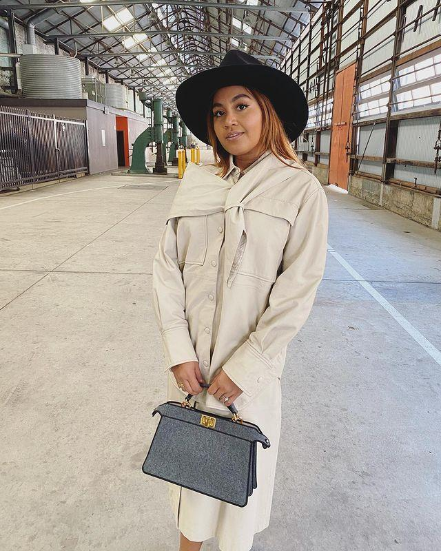 Talented songstress Jessica Mauboy wrapped up in a muted camel-tone coat paired with a wide brimmed hat. The perfect preppy ensemble.