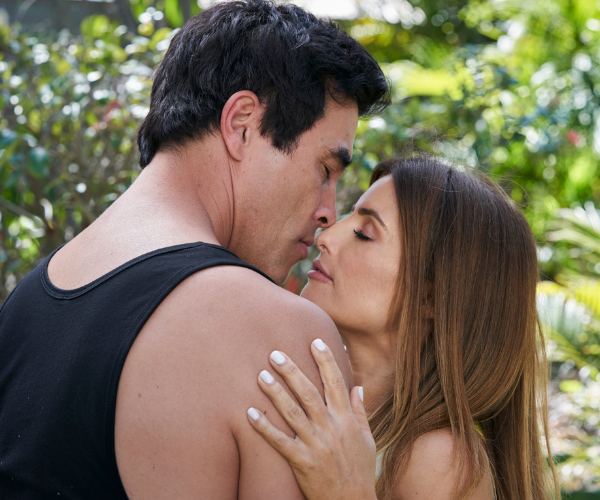James Stewart and Ada Nicodemou acting out an intimate scene on Home and Away.