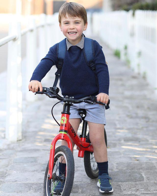 Prince Louis poses on his bike for his official birthday portrait, which was released to mark his third birthday.