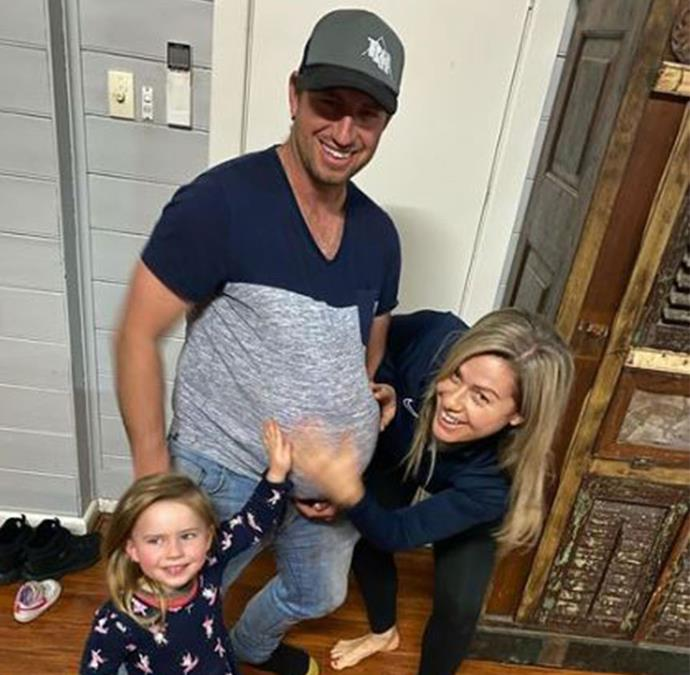 Mark, joined by his daughter Stevie and partner Marie, poses with a fake pregnant belly.