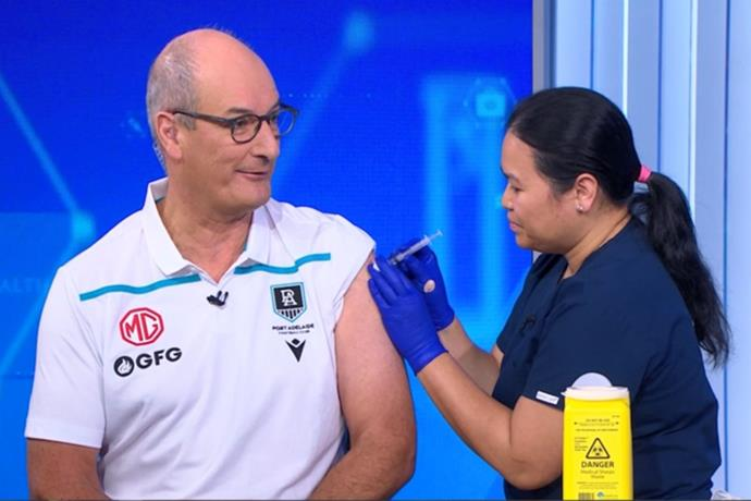 **David Kochie** <br><br> *Sunrise* host David Kochie, 65, received his vaccine alongside Natalie on live television. <br><br> However, he struggled not to wince as he kept his eyes away from the nurse.