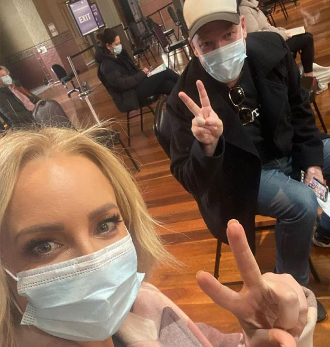 """**Peter Helliar** <br><br> The comedian joined Carrie with his wife, Bridget Helliar, to get his vaccination.  <br><br> He posted a series of pictures on Instagram and paired them with a lengthy caption to encourage people to get their vaccine. <br><br> """"First jab ✅. Thank you to all the staff who are running an incredibly smooth operation at the Royal Exhibition Building in Melbourne,"""" the 45-year-old wrote. <br><br> """"If you are eligible get vaccinated to help protect our state & country against this hideous virus. Thanks @brijmurphy & @bickmorecarrie for being my vax partners!."""""""