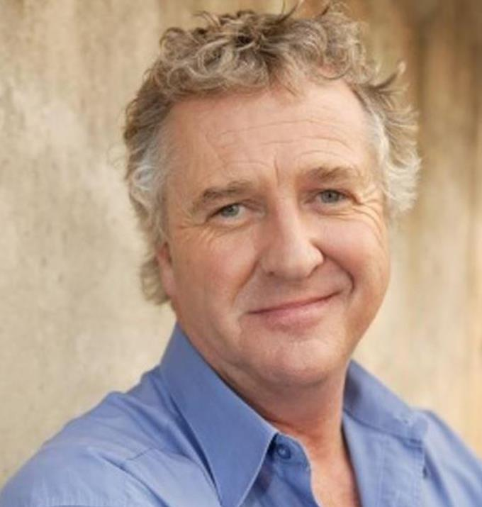 **Shane Withington**  <br><br> Shane plays surf lifeguard John Palmer and is 62.
