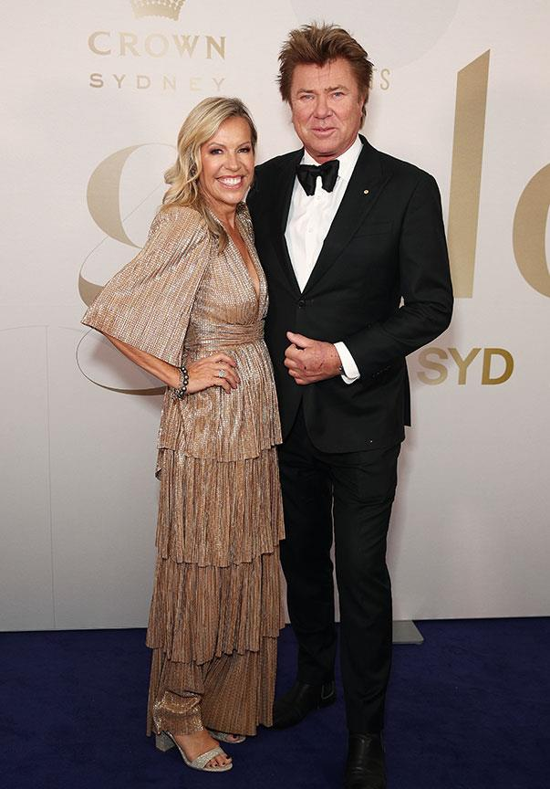 Richard Wilkins' girlfriend Nicola Dale embraced the gold theme wholeheartedly in this tiered metallic number.