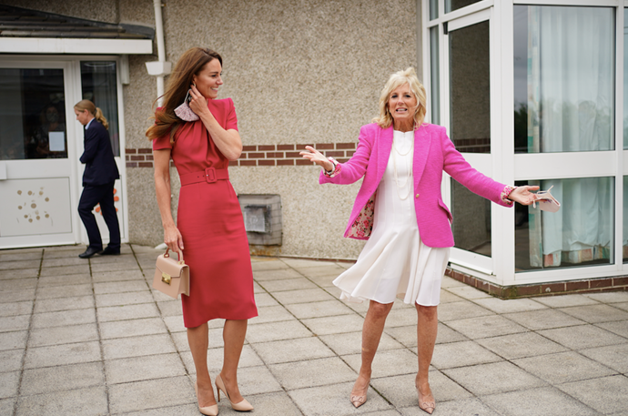 The two influential women wore shades of pink for the special event.