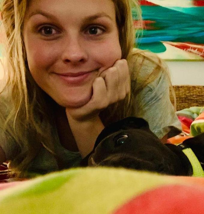 **Sophie Dillman**  <br><br> Sophie looks so relaxed sans makeup and cuddled up with her cute dog on her bed.