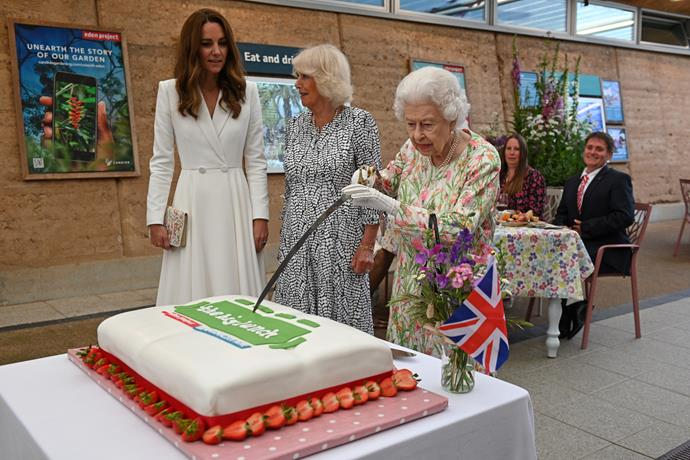 The Queen cut her cake with a large sword, as you do...