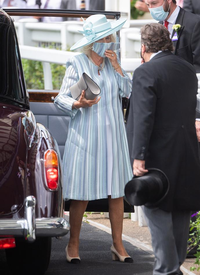 Stepping out to lead the royal pack on day one was Camilla, Duchess of Cornwall who looked beautiful in a cornflower blue ensemble - complete with a matching mask!