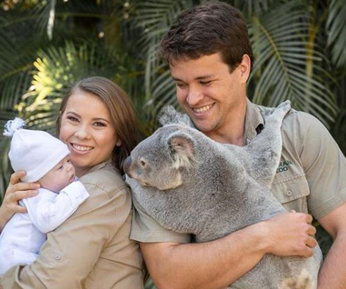 Proud new parents Bindi Irwin and Chandler Powell introduce daughter Grace to a friendly koala at Australia Zoo.