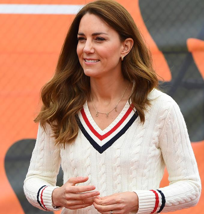 Kate pictured in another necklace, also featuring the letters G, C and L.