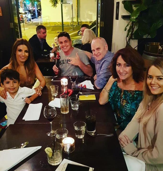 Everyone looks gleeful at this *Home and Away* plus family dinner.  <br><br> From the left is Ada Nicodemou, her son Johnas, Johnny in the middle, and from the left is Tahnee Sims, Lynne and her husband.