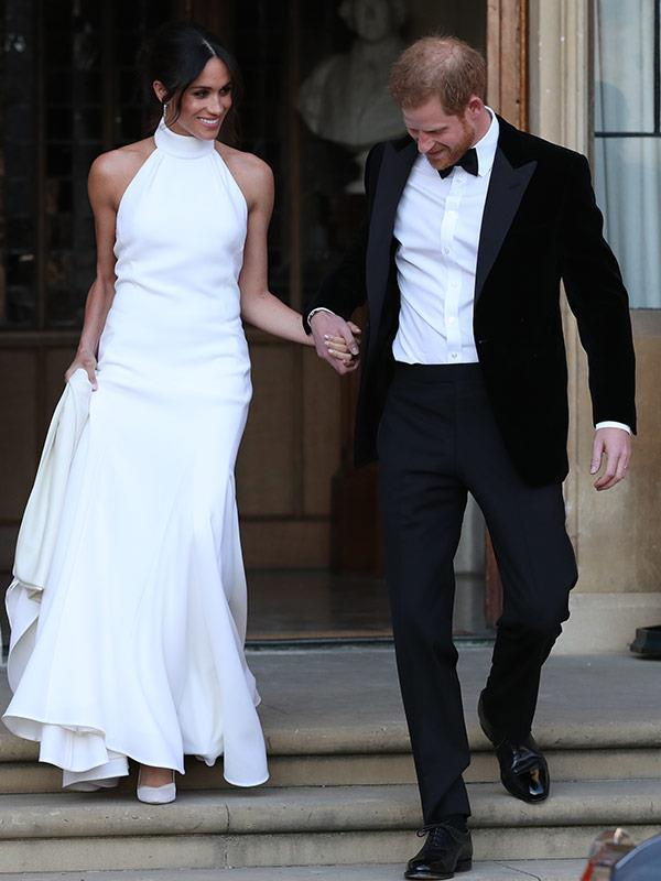 """The Duchess of Sussex's toned and slender arms stole the show when she stepped out in this sleeveless [Stella McCartney gown at her wedding reception.](https://www.nowtolove.com.au/fashion/fashion-news/meghan-markle-second-royal-wedding-dress-48442
